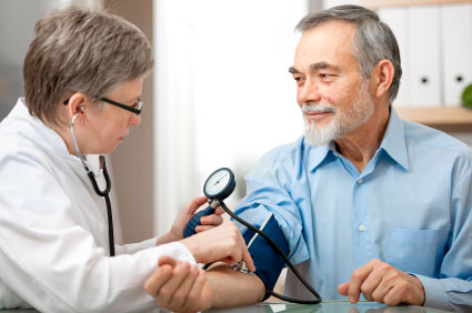 doctor measure blood pressure of older man
