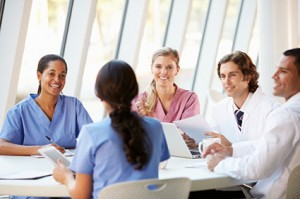 healthcare profesionals talking at a table