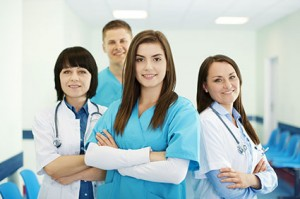 healthcare professionals with arms folded